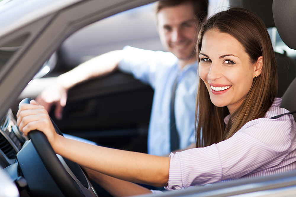 Man And Woman Sitting In Car Smiling Out Window