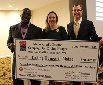 MECUL President And Others Holding Big Check For Ending Hunger In Maine