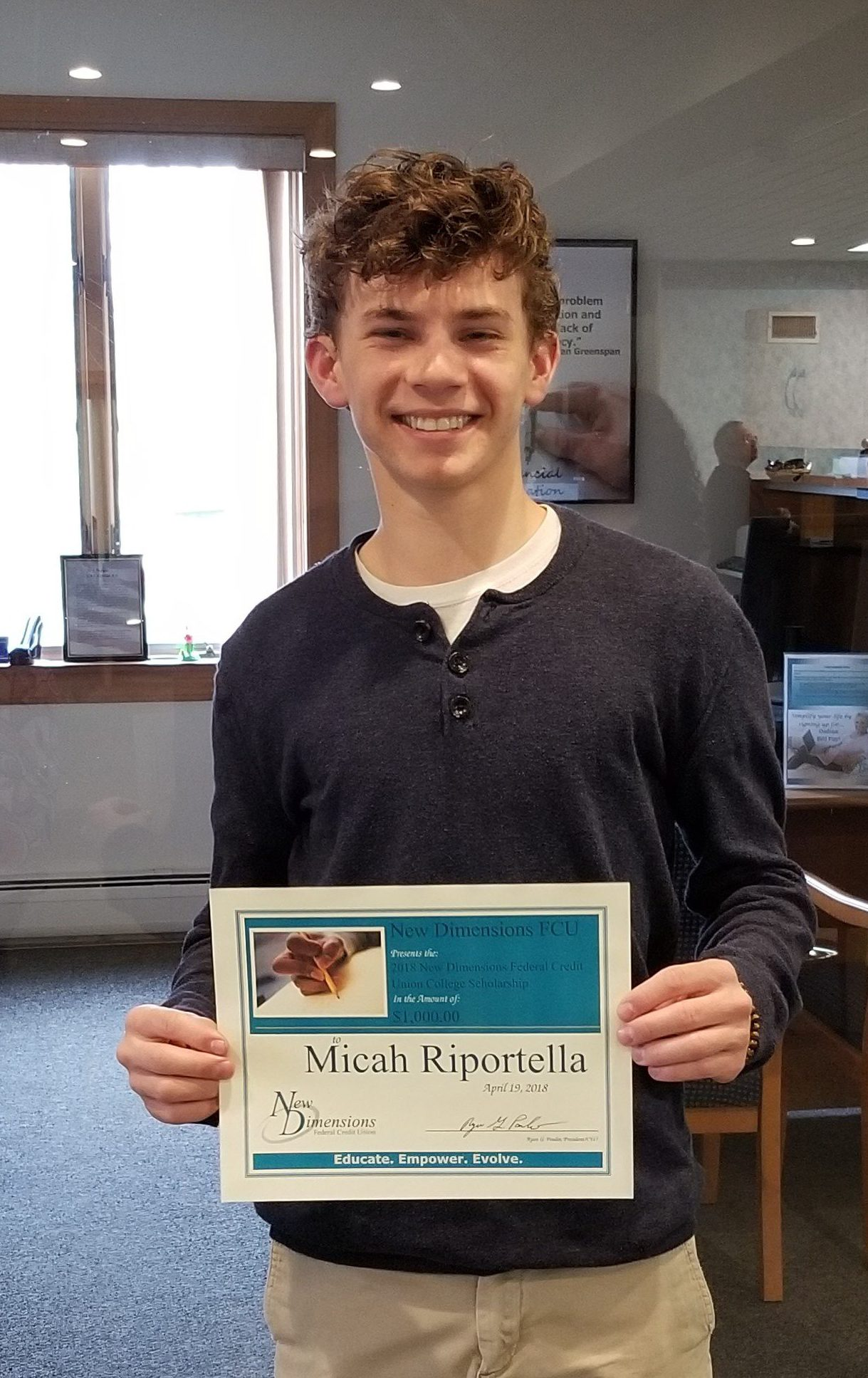 Photo Of Micah With Certificate .winner Of Scholarship Award