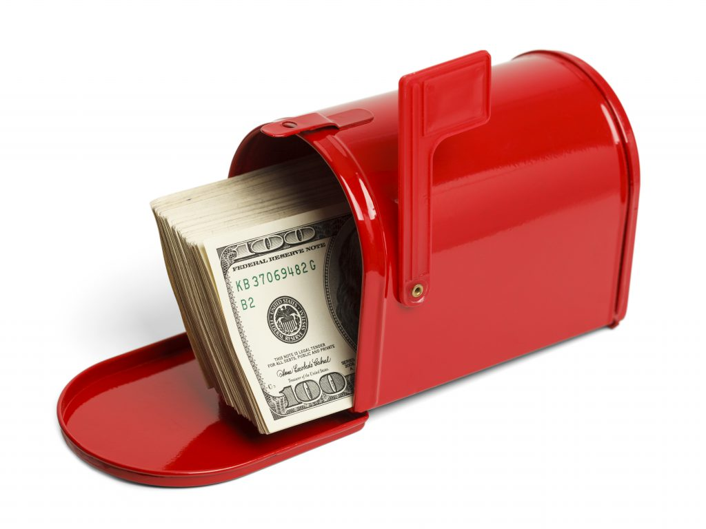 red mailbox with money in it. tax refund