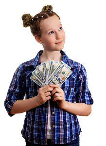 little girl holding US dollars