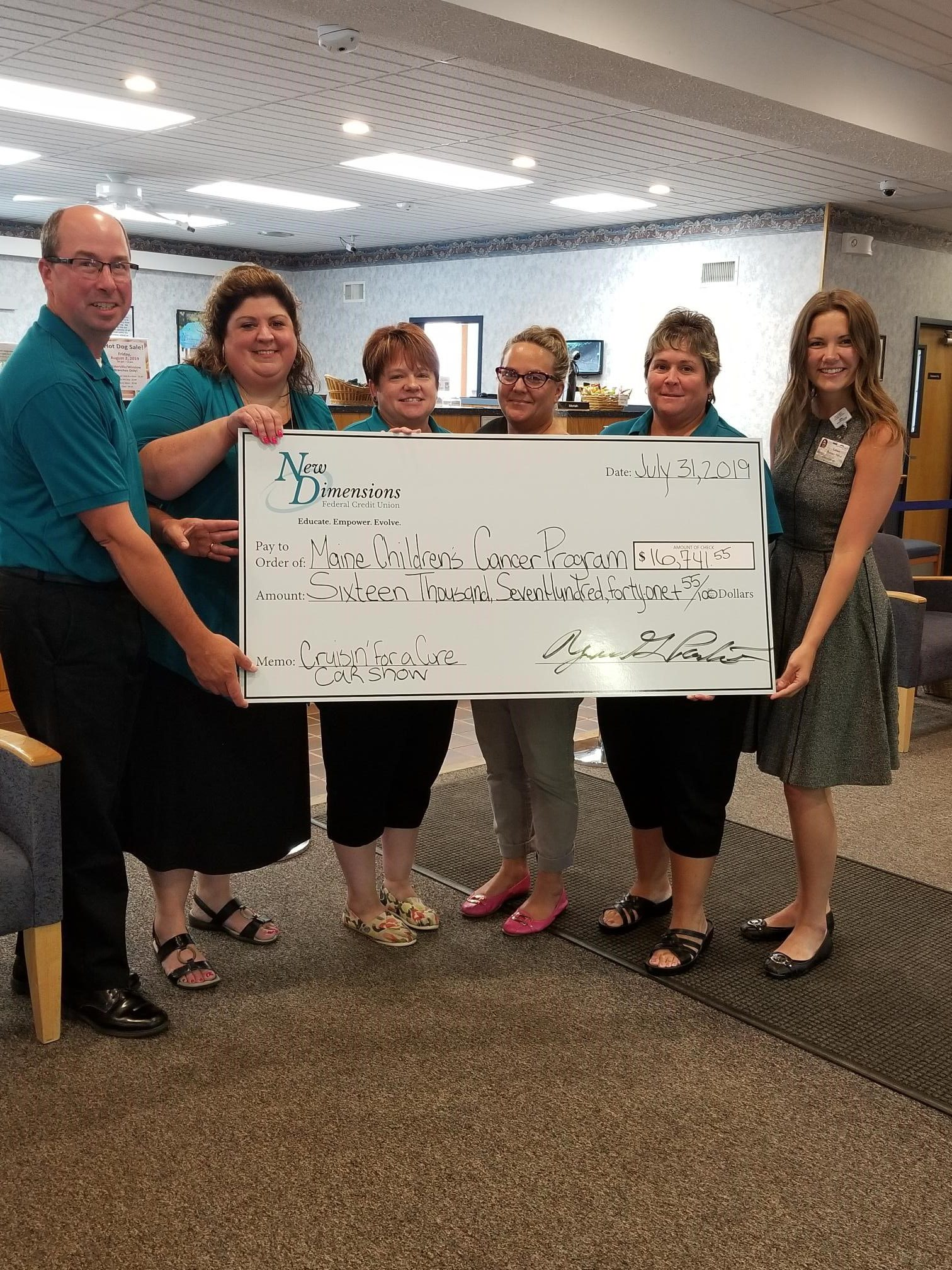 Big Check Presentation With Staff Of NDFCU