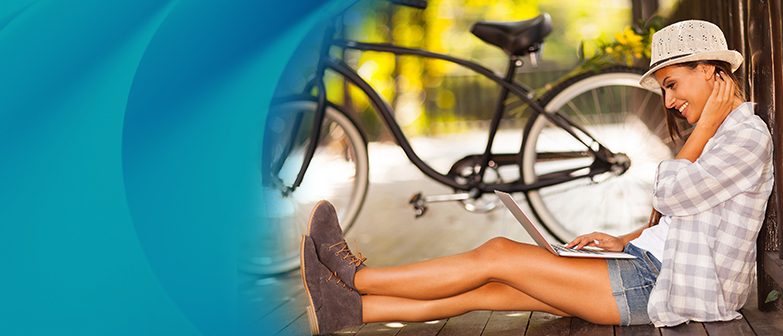 girl sitting next to bike with tablet