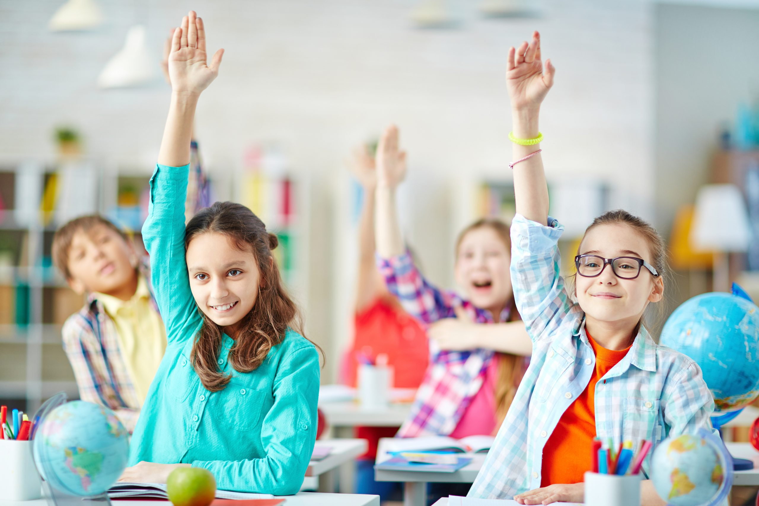 Classroom Of Kids Raising Hands